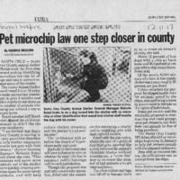 20170607-Pet microchip law one step close0001.PDF
