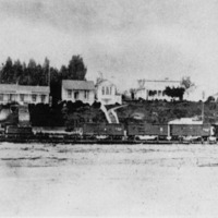 Railroad train on the beachfront, after line was broad-gauged